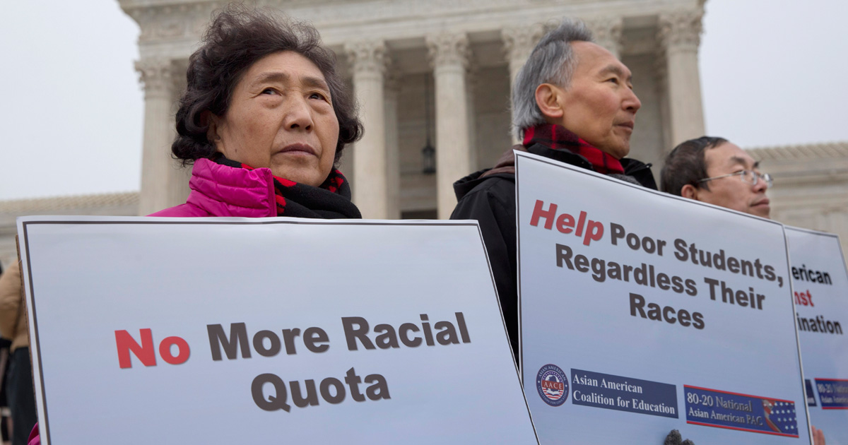 A picture of people gathering around protesting against Asian American racial quotas