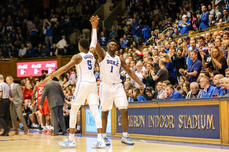 Zion Williamson and RJ Barrett celebrating