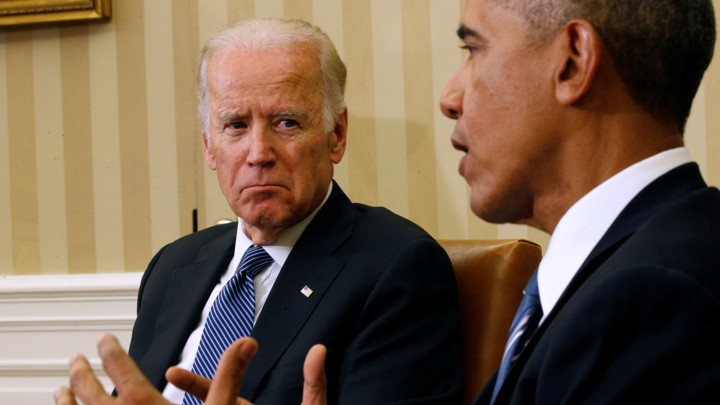 U.S. Vice President Joe Biden listens as U.S. President Barack Obama speaks about the release of the Cancer Moonshot Report at the White House in Washington October 17, 2016.REUTERS/Kevin Lamarque - RTX2P85D