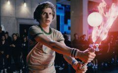 Scott Pilgrim yielding a fire katana for a video game-like boss battle