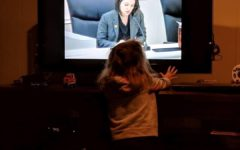 Mrs. Cutrone's daughter watching her at a council meeting on TV